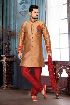 Step the look up a few notches in this peach puff color silk men's wear sherwani. You'll see some intriguing patterns accomplished with gold zardosi and patch work. Sherwani Groom, Mens Sherwani, Wedding Sherwani, Indian Man, Indian Ethnic Wear, Style Indien, Latest Mens Wear, Ethnic Looks, Casual Blazer