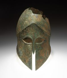 Corinthian (ancient style) Helmet, 500 BC - 470 BC  Bronze - 11 3/16 x 6 13/16 x 9 3/16 inches Museum Works of Art Fund 43.185