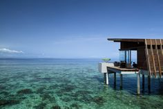 house on stilts over aqua waters