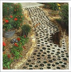 Beer bottle garden path - or any colored glass bottle bottoms - now that's a thought.