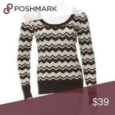 "Tory Burch Chevron Neutrals Sweater, Small 100% wool (lightweight and soft). Size small.  Brown and grey Tory Burch wool pointelle knit sweater with long sleeves, scoop neck, chevron pattern throughout and rib knit trim. Condition: Very Good. B+ Measurements (approx): Bust 34"" Waist 34"" (17"" side to side) Length 24"" Fabric Content: 100% Wool Designer: Tory Burch Item # WTO62813 Tory Burch Sweaters Crew & Scoop Necks"