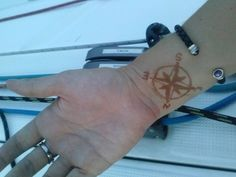 May need to have this done again... #tbt #throwback #sailing #sailorgirl #sailorchick #compass #tattoo #direction #compassrose #henna #sailor #bodyart #wrist #sailboat #sailinstagram by harborhotness