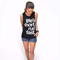 No time to dilly dally. Get out there and live life to the fullest: Life's Short, Run Fast.  Printed with a vintage ink to keep that soft feeling even with the print, this super soft, flowy muscle tank with draping fabric and elongated armholes, is so comfy you'll never want to take it off.   Size Guide:     Fits Sizes  S M L XL      2-4 6-10 10-14 14-18