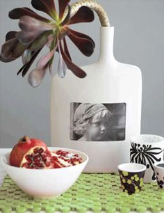 copy a picture onto transparent sticky paper and place on a white vase. Perfect for a memorial service or a sympathy gift