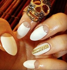 stiletto nails with half moon; I like these, her are a tamed more subtle version of the stiletto nails.
