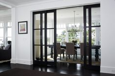 Suzie: LDa Architects - Contemporary dining room with glass pocket doors, glossy black dining ...
