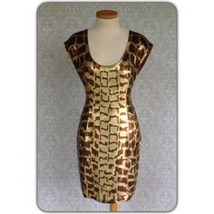 "COCKTAIL DRESS Vintage dress in very good condition. Heavily sequined in gold and brown.  Size says 8. Runs small. 17"" across chest 15"" at waist 19"" at hips. No missing sequins.  35"" long from shoulder. Small slit bottom back of skirt A.J. Bari Dresses"