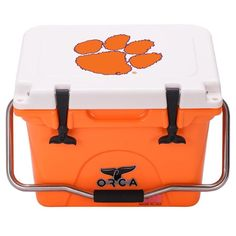 Keep food and beverages cold while displaying your college team pride with the Collegiate ORCA Cooler. Adorned with the logo and colors of your favorite school, it features durable roto-molded construction with integrated insulation and lid gasket. Extra Storage Space, Storage Spaces, Tailgate Food, Tailgating, Cargo Net, Clemson Tigers, Outdoor Parties, School Colors, University