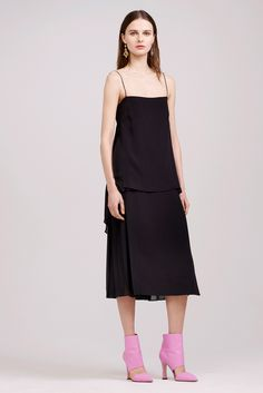 Adam Lippes Fall 2015 Ready-to-wear had influences from the 90's especially in this spaghetti strap basic black dress. It is a bit longer than dresses in the 90's but the simplicity of it resembles trends in dresses during that time. Other pieces from the 90's in this collection were the larger turtle necks and cowl necks. 4/6/15