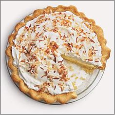 With flavors better than the traditional version, the Cooking Light Test Kitchen shaved over 200 calories and 10 grams of saturated fat off this coconut cream pie while still maintaining its creamy, fluffy Italian meringue.