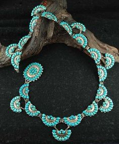 Concho Belt   Lee and Mary Weebothee. (Zuni). Silver and natural Sleeping Beauty turquoise. ca. early 1970s
