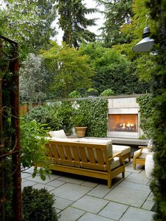 Here, evergreen ivy covers the wall and surrounds the outdoor fireplace