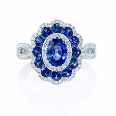 Diamond and Blue Sapphire White Gold Flower Ring Luxury Jewelry, Bling Jewelry, Jewelry Rings, Jewellery, White Gold Jewelry, Blue Sapphire Rings, Expensive Jewelry, Gold Flowers, Beautiful Rings