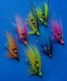 A few from a while back...... some jazzed up a bit with powder paint   http://www.canadiantubeflies.com/flytying-powder-paint.html