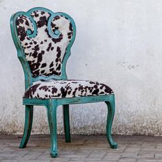 Stylish turquoise + cow print accent chair.