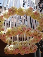 Flower Balls hanging from the ceiling from ribbon like a chandelier - prominent floral arrangement