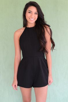 The little black romper is just as important as the little black dress. Make this black, high neck romper by C.luce a staple item in your closet! This gorgeous piece has a low back completed by a bow,