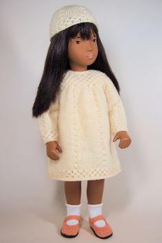 Yoke Dress with Knot Patterns (Pattern no. designed specifically to scale for Sasha and Cora dolls by profesisonal knitwear designer and author of Sasha Dolls: The History Susanna Lewis, United States, by Susanna's Knitting Patterns. Doll Patterns, Knitting Patterns, All American Girl, Sasha Doll, Doll Maker, Dollhouse Dolls, Knitted Dolls, Doll Clothes, Knitwear