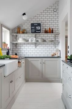 Open shelving and the brick focus wall make this kitchen seem bigger than it is. Interesting mix of beige and white