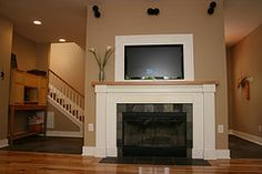 woodburing fireplace with tv above