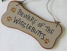 Beware of the Wigglebutts Handpainted Sign on Recycled Wood. $15.00, via Etsy.