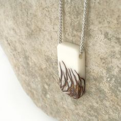 Ecoresin and pinecone long rounded pendant