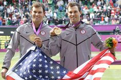 Gold medalists — and twins — Bob Bryan (left) and Mike Bryan pose after the medal ceremony of the men's doubles final. The Bryans completed a career Golden Slam by defeating Jo-Wilfried Tsonga and Michael Llodra of France.