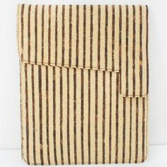Designed by Shaylyn Lam Applicable to iPad / iPad mini / iPad air Beautifully with invisible magnet opening Material: Corkwood Fabric with special stripe pattern (Unique Corkwood Fabric from Taiwan, rare on the market), High quality cotton lining Size: (H) 26.5cmï¼› (L)21.5cm Production lead time: 5 working days Welcome custom-made order