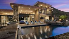 luxuriously rectangular pool designs in geometric pool designs with blue sundeck chairs, waterfall, stone floor, plafondlamps, and cactus