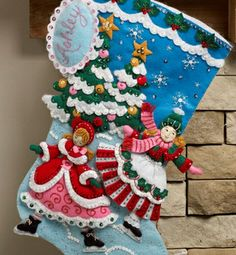 """SKATERS FELT STOCKING KIT 18""""  Make these beautiful 18"""" Christmas Stockings for your family as an heirloom they can keep.  Festive designs, quality materials and generous embellishments continue to make Bucilla ® felt stockings a favorite stitchery tradition. Stocking kits include: stamped felt, embroidery floss, sequins, beads, needles and tri-lingual instructions."""