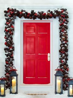 Pinecone & Ornament Garland - Create a striking & festive look for your holiday front door with this pretty garland. Customize a purchased pinecone garland with ornaments that coordinate with your door color, using florist's wire to secure the ornaments. Position the garland outside the door frame; secure at the top & along the sides with easy-to-remove self-adhesive hooks or brick clips. Finish the warm entry with white pillar candles set inside tall glass lanterns adorned with holiday…