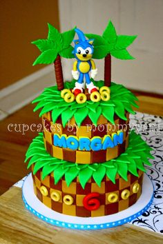 Sonic the Hedgehog Birthday cake  This is sooo cute and what a great talent that went into this cake.  :-)