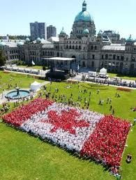 Canadian flag in front of the Legislature Bldg in Victoria British Columbia