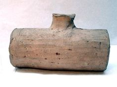 13th c-14th c. Costrel; pottery; cylindrical with neck; spots of green glaze.
