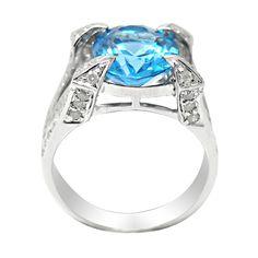 <li>14k white gold ring</li><li>Blue topaz and diamond jewelry</li> <li>Available in size 7 only</li> <li><a href='http://www.overstock.com/downloads/pdf/2010_RingSizing.pdf'><span class='links'>Click here for ring sizing guide</span></a></li>