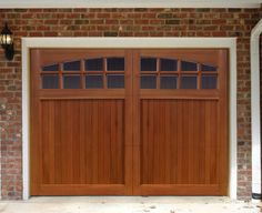 Sunburst Garage Door	 - $2,399.00  This look on my present garage would soften the look of the house!  Must find a less expensive then this Alaskan Cedar Wood Faced model.