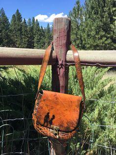 Vintage Stamped Leather Saddle Bag-Stamped Leather Saddle Bag-Handmade Vintage Purse-Tooled Leather Purse-Sturdy Leather Saddle Bag by Rhinestonedcowgirls on Etsy https://www.etsy.com/listing/485026888/vintage-stamped-leather-saddle-bag