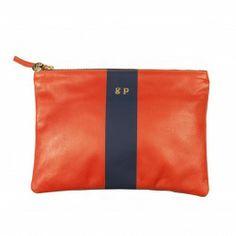 NEED Clare Vivier   Exclusive  orange & navy stripe clutch   goop.com