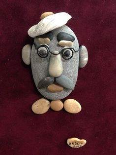Pebble art portrait by gülen