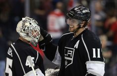 Goaltender Jonathan Bernier #45 and Anze Kopitar #11 of the Los Angeles Kings congratulate one another following their teams 2-1 victory over the Detroit Red Wings at Staples Center on February 27, 2013 in Los Angeles, California.
