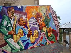 Mosaic wall on East 11th Street, created by John Yancey, Luis G. Alicea, and Steven B. Jones.