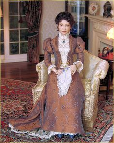 Corrine is a beautiful lady from 1890. She is dressed in a gorgeous silk brocade gown. Sitting by the fire she is working on an embroidery.