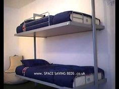 http://www.spacesavingbeds.co.uk/Foldaway-Bunk-Bed.htm - Foldaway bunk bed from space saving beds .co.uk. Wall bed with two single foldaway beds. Easy to use...