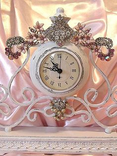love the use of the vintage jewelry on this clock