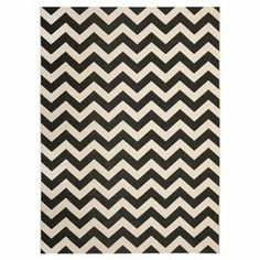 Loomed indoor/outdoor rug in black and beige with a chevron motif. Made in Turkey.  Product: RugConstruction Material: Synthetic fiberColor: Black and beigeFeatures:  LoomedSuitable for indoor or outdoor use  Note: Please be aware that actual colors may vary from those shown on your screen. Accent rugs may also not show the entire pattern that the corresponding area rugs have.Cleaning and Care: Sweep, vacuum, or rinse off with a garden hose