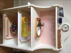 Lesson shelves for a toddler from Simplynaturalmom.com