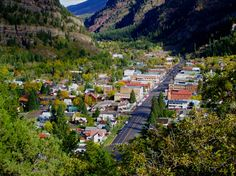 Ouray, CO.  Beautiful little town nestled totally amid the mountains.  Gorgeous destination while in Colorado.