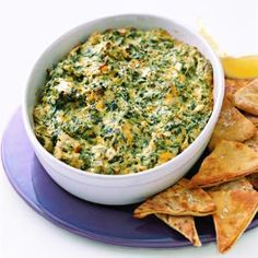 This easy spinach-artichoke dip recipe boasts extra creaminess with the addition of both sour cream and whipped cream cheese. Serve it warm with pita chips, tortilla chips or French bread.