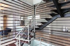STAIRCASE BY JOOS  This wooden staircase, enveloped with sexy slatted screens, shows that a practical set of steps can also double as a stylish showstopper. http://joos.co.za/custom-staircase/