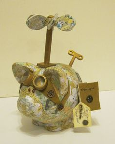 A Steampunk pig made for a fundraiser. He's a world traveler ready for his next adventure!!